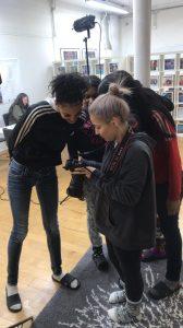 People huddled around a camera