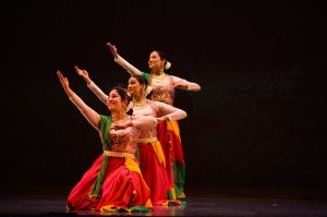 Three women dancing in unison