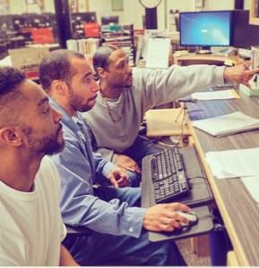 3 men work together at a computer